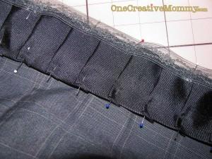 Pin hem tape over the ribbon