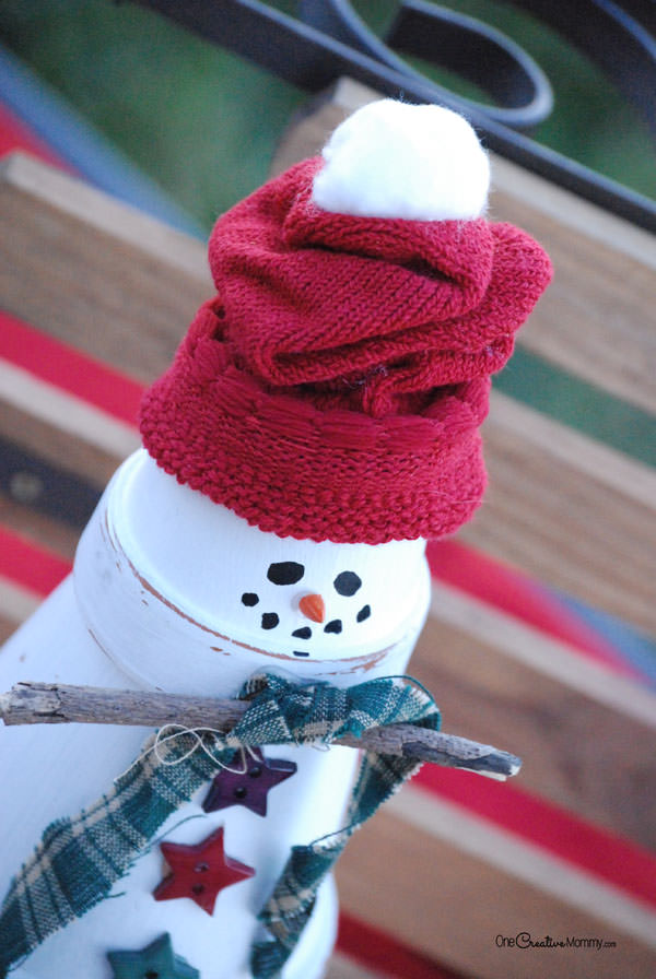 Easy Terra Cotta Snowman Tutorial from OneCreativeMommy.com--Closeup of face